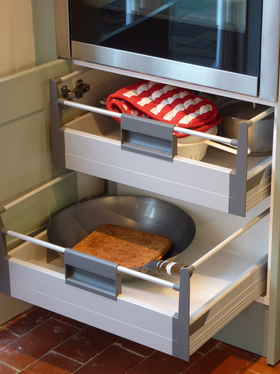 interior pan drawers made by Blum sit behind traditional Shaker door