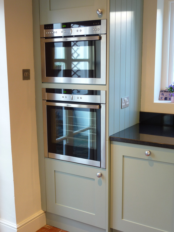 Blue grey painted kitchen by peter henderson furniture for Tall fitted kitchen unit