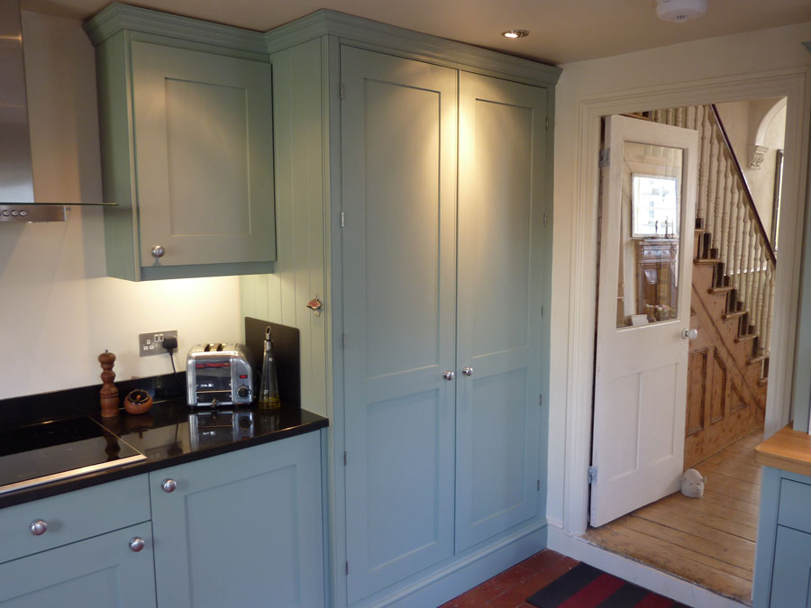 custom made kitchen painted in Farrow and Ball blue-grey
