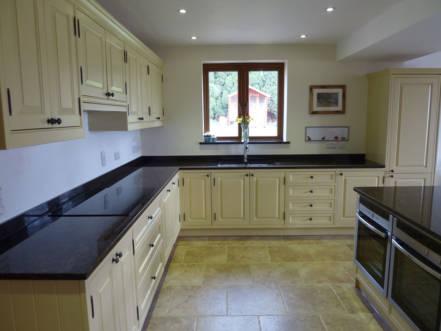 this kitchen was made in solid tulipwood and hand painted using farrow