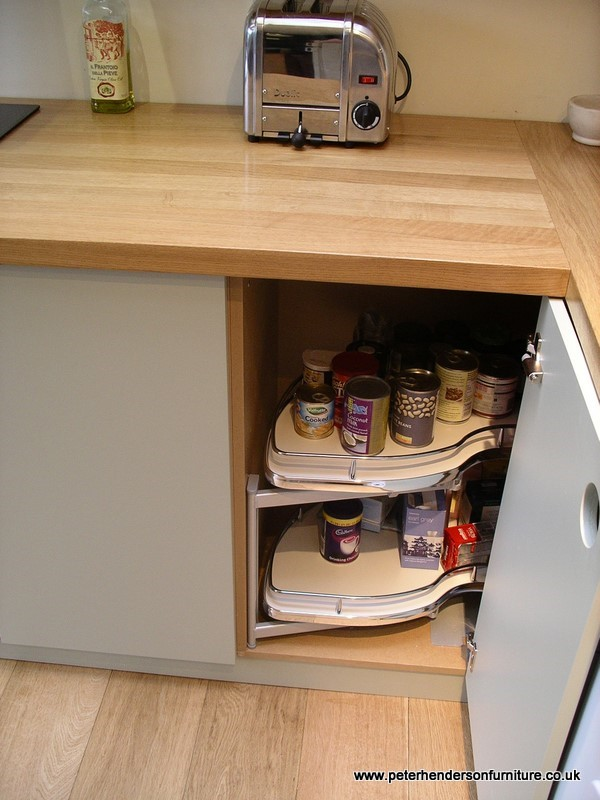 this corner pull out unit is a simple but clever design that allows a : built cabinets