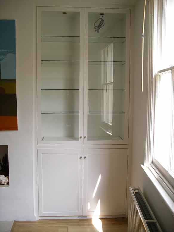 fitted cabinet with glazed doors